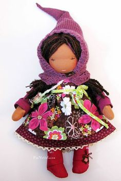 Sheyla is a 15'' tall FeeVertelaine doll.  She has beautiful terra cotta skin, brown eyes, and brown hair with fuschia highlights.  She comes with her complete outfit {dress, apron, knitted poncho, panties, boots and a little purse}.