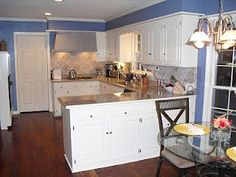 blue kitchen with white cabinets - @Emily Liles this reminded me of you!