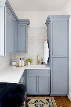 Stephanie Gamble Interiors - Hampton, MD project - Laundry Room - Painted Cabinets - Brass Hardware - Blue Cabinets - Newport Brass East Linear faucet satin brass - Quartzite countertops