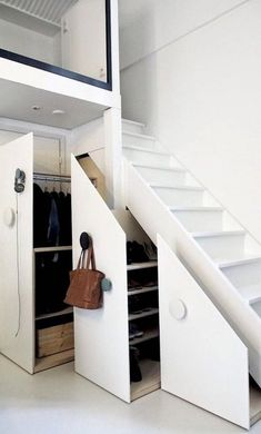 Stairway doubling as a closet is a great way to maximize often times wasted space. Find other home design and interior decorating ideas, tips and inspiration on my blog: http://www.inspiredtostyle.com