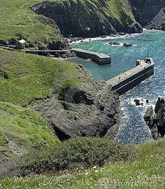 Scenic high angle view of Mullion Cove harbour, Cornwall, England.