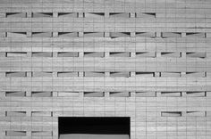 Oficinas para la Delegación Provincial de Salud by Alberto Campo Baeza        The shutters are made of stone, which regulates the amount of light entering the rooms, and when all the shutters are closed, the building appears to be solid stone.