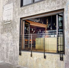tri-fold doors, brass bar & connection to street Multi Disciplinary, Adaptive Reuse, Construction, Bread, Architects, Building, Outdoor Decor, Tri Fold, Fence
