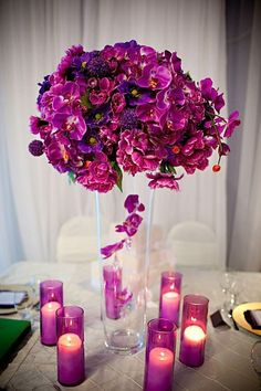 purple wedding centerpiece and candles: not the tall centerpiece (eww) but the candles!