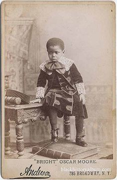 Full length portrait of a young African American boy in velvet suit and elaborate lace collar and cuffs, ca. 1875. Randolph L. Simpson African-American collection. Beinecke Rare Book and Manuscript Library, Yale University.  Vintage African American photography courtesy of Black History Album, The Way We Were.  Follow Us On Twitter @blackhistoryalb