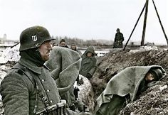 Waffen SS Soldiers sheltering in their trench from the cold somewhere on the Eastern Front.