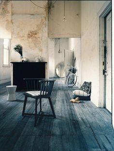 Distressed tinted wood floor.