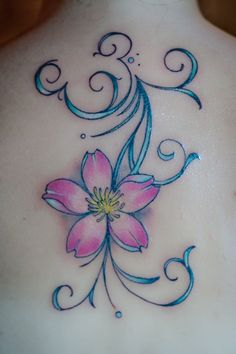 Disney tattoo....with a hidden Mickey. I LOVE THE IDEA OF A HIDDEN MICKEY BUT NOT THE FLOWER