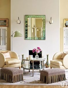 Midler's dressing room is graced with an Art Deco mirror and Paris flea-market chairs; the stools are covered in a Brunschwig & Fils print.