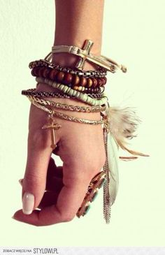 Boho Chic. Layers of textured bracelets and dainty gold bits.