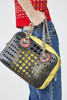 Prada Resort black and yellow chain hole bag - 'Swish' For Oyster Mag shot by Adam Bryce, Styled by Chloe Hill