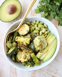 The Green Vegan Buddha Bowl is filled with grilled veggies, green tahini sauce, avocado & quinoa for a healthy, filling meal that's also gluten free! Vegan Recipes Videos, Vegan Dinner Recipes, Vegan Recipes Easy, Organic Recipes, Veggie Recipes, Salad Recipes, Vegetarian Recipes, Veggie Meals, Chili Recipes