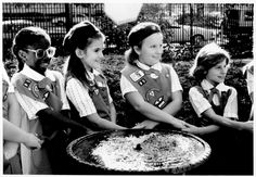 Girl Scout Juniors in the 1980s participate in a circle of friendship ceremony at Juliette Gordon Low Birthplace in Savannah, Georgia!