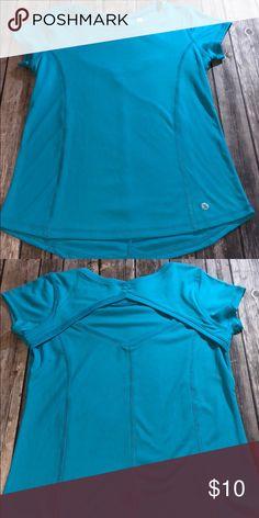7c1d8e60eecc Girls light blue athletic top Girls light blue athletic material top with a  cut out in