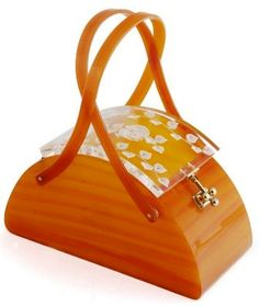 Vintage lucite box bag                                                                                                                                                     More