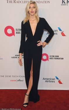 Blonde bombshell: Devon Windsor looked sensational in a plunging black gown which featured a thigh-high split