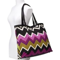 """Missoni for Target Women's Large Tote Shoulder Bag - Passione. · Dimensions: 14.5 """" H x 17.0 """" W x 5.5 """" D. · Fabric Treatment: Faux-Leather / Closure Style: Snap Closure. · Shell Material: Canvas, Cotton / Liner Material: Cotton, Polyester. · Handle Type: Double Shoulder Handles. · Interior Features: Slit Pocket, Zip Pocket, Cell Phone Pocket."""
