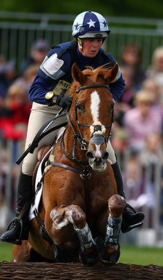 Lucy Wiegersma and Shaabrak go through the Water Jump during The Cross Country phase of The Mitsubishi Badminton Horse Trials...