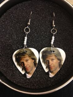 Bon jovi white guitar pick earrings by codascrafts on Etsy, $5.99 @Lin Wei Ling Lorenz ! haha closest HE will ever get to my neck!  hahahaha