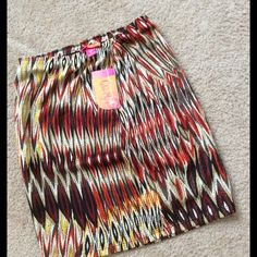 Lightweight skirt. Aztec design.  Multicolored lightweight skirt. Red orange yellow brown tan.  Great with sandals or tights and boots. Junior size medium. NWT. Catch My I Skirts