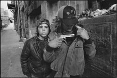 """A collection of 22 unforgettable photos by documentary photographer, Mary Ellen Mark. Above: """"Rat"""" and Mike with a gun. Seattle, 1983"""