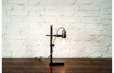 This cute little fellow is an industrial inspired desk lamp from the Saigon based furniture makers District Eight Design.