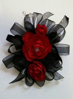 Red and Black Wrist Corsage By Bride & Bloom Gladwin, Michigan