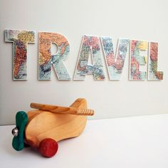 Love the letters for travel room with trinkets from all the places I've been