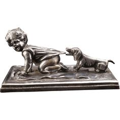 WMF German silverplate paperweight of a child being pulled by a Dachshund circa late 19th C $300