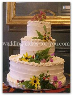 A simple wedding cake with fresh flowers by Lorelie @wedding-cakes-for-you.com