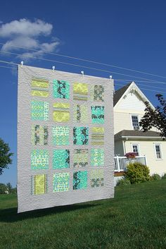 Quilt made of Amy butler;  Kate liked the solid background and colors;