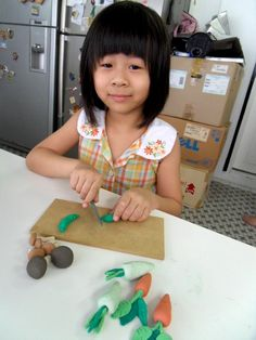 Juilet creating her clay vegetable ready to eat http://gariesim.blogspot.sg/2014/04/all-creative-learning-for-children.html