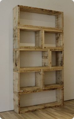 Pallet shelf. Lovveeee this look! And Jesse said he'd be making a big bookshelf for our home :) I want it... Wall sized :) we have enough books to fill it!