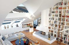 open plan loft with amazingly high ceilings for library!