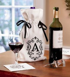 Monogrammed Wine Bag with Ribbon Bows, Letter C by Plow & Hearth®. $4.99. Monogrammed wine bag. Contrasting ribbon bows. Specify single letter. Great holiday and hostess gift. Our Monogrammed Wine Accessories are great holiday and hostess gifts. Our handmade 3-D laser-etched glass Wine Stopper is a unique addition to your wine collection or wet bar. Metal base with silicon O-rings to seal in freshness. Wine Bag is made of white polyester and features a contrasting black...