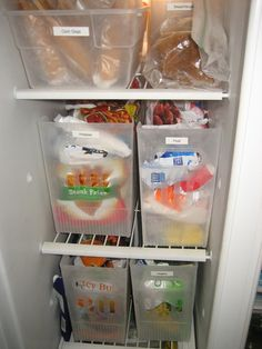 Organized!! Upright Freezer storage bins hold all those odd to store freezer food bags (Container Store online, they are multi purpose large magazine type bins)