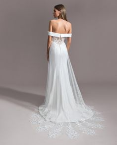 Ti Adora by Allison Webb bridal gown - Ivory crepe sheath. Detachable off the shoulder banded neckline with a soft sweetheart neckline underneath. English net overskirt with lace appliques along the hem. Buttons extend to the end of the train. Wedding Dress Styles, Designer Wedding Dresses, Bohemian Girls, Vintage Romance, Bridal Stores, Bridal Boutique, Lace Applique, Designer Collection, Beautiful Bride