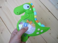 Dinosaur I spy game is the great pattern of quiet toy for babies and kids! Kids task is to find buttons among the beads inside the dinosaurs tummy! it rattles well as well! This sensory quiet game is perfect for long travels, waiting at doctors or at church! The game helps to develop fine motor skills, tactile perception, intellect, imagination! Made to order, you may choose any form for I spy bag - a fruit or a vegetable, the animal, e.g., rabbit or owl, and even an alien visitor) Size…