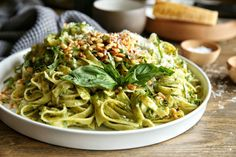 Avocado Pesto Fettuccine  I'd add more salt and use a VitaMix to create the pesto sauce. I can't wait to try this!