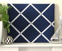Padded Fabric Covered Bulletin Board With Ribbon And White Frame
