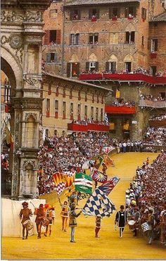 Il Palio di Siena, Italy -- a horse race that is held twice each year, on July 2 and August 16, in Siena, Italy. Ten horses and riders, bareback and dressed in the appropriate colours, represent ten of the seventeen contrade, or city wards - here a part of the Corteo Storico pageant that precedes the race. [info from Wikipedia]