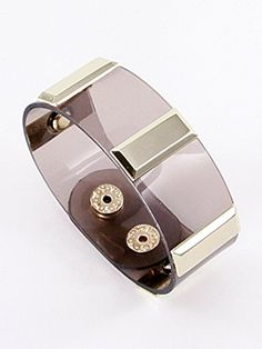 Fashion Clear Leather Bracelet Snap Button Closure Materials Metal Materials Clear Leather Length 8.5 Inch Width 1.0 Inch Unknown http://www.amazon.com/dp/B00KXATE6I/ref=cm_sw_r_pi_dp_JvMLvb147B296