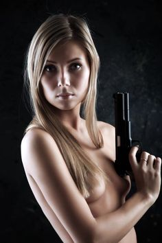 Pretty lady holding a firearm.