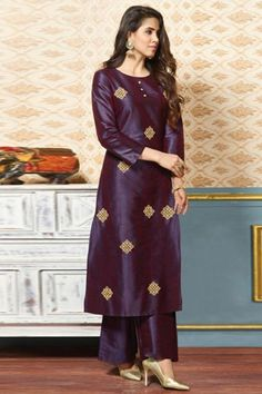 Dazzle everyone around as you walk into a wedding wearing this Violet Silk Trouser Suit which makes it astonishingly charming. This Round neck and Quarter Sleeves garment embellished in zari and stone work. Silk Kurti Designs, Salwar Designs, Kurta Designs Women, Kurti Designs Party Wear, Stylish Dress Designs, Designs For Dresses, Stylish Dresses, Kurta Neck Design, Indian Designer Suits