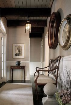 So much detail in this entry..Floors, beams, grass cloth wallcovering...Furnshings...