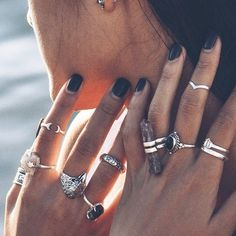 Love all of these rings... silver, knuckle rings, stones