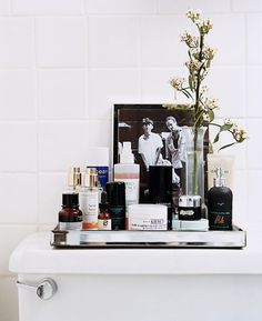 The chicest and easiest way to cut down on clutter: A gorgeous tray. #tinytweaks