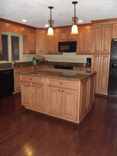 Kitchen Remodel Pictures Maple Cabinets maple kitchen cabinets with dark wood floors, dark countertops