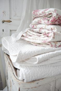 Love the cozy stack of these quilts - look so inviting and warm... just right for a cold winter's night!