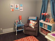 I love the grey walls, with pops of orange and blue.  Would be great for baby girl or baby boy